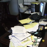 Messy desk full of clutter